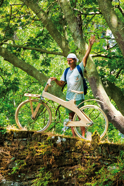 Paul Evmorfidis with his wooden bike on nature