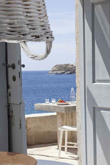 a semi open door looking at the sea of Serifos at COCO-MAT Residences Resort